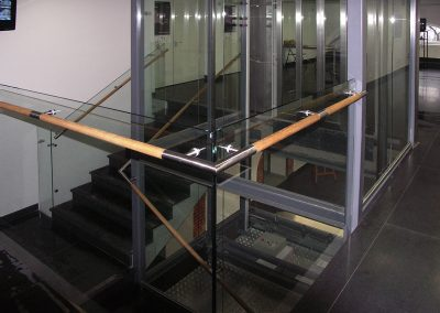 11 Multimaterial balustrades Brass steel glass and wood