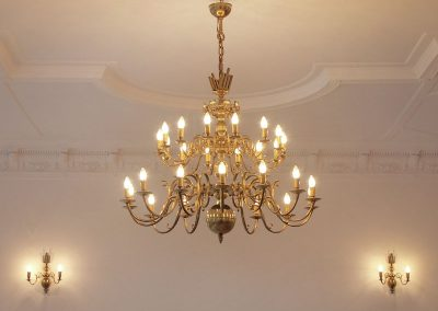 Stylish brass chandelier production and installation in Europe